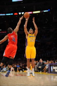 Los Angeles Lakers point guard Shannon Brown protects the ball during the game against the Los Angeles Clippers at Staples Center on March 25 2011 in...