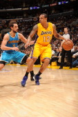 Los Angeles Lakers point guard Shannon Brown protects the ball during their action against the New Orleans Hornets in Game Five of the Western...