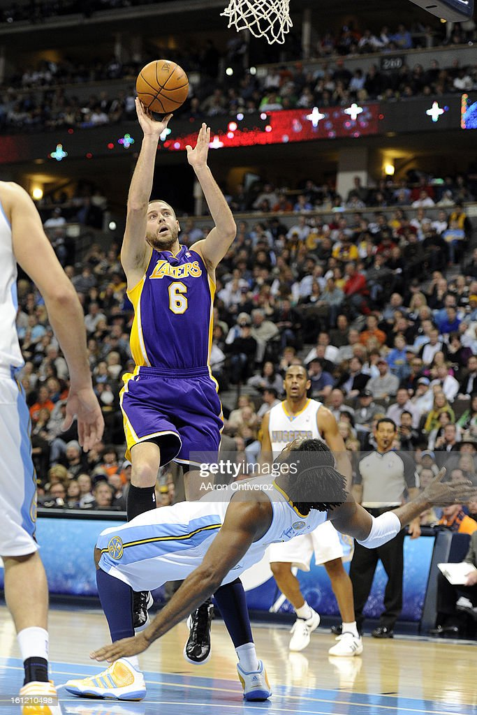 Los Angeles Lakers power forward Josh McRoberts (6) charges Denver Nuggets center Nene (31) during the second quarter at the Pepsi Center on Sunday, January 1, 2012. AAron Ontiveroz, The Denver Post