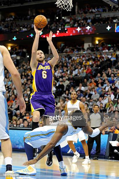 Los Angeles Lakers power forward Josh McRoberts charges Denver Nuggets center Nene during the second quarter at the Pepsi Center on Sunday January 1...