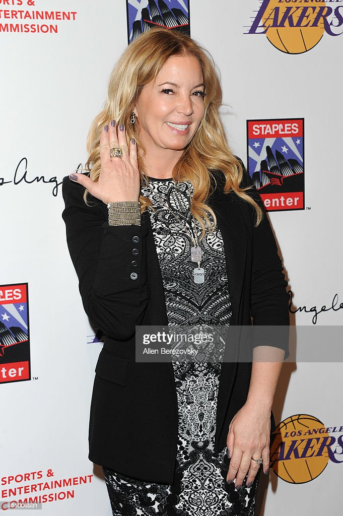 Los Angeles Lakers president of business operations Jeanie Buss shows off her Lakers championship ring on the right hand and her engagement ring on the left hand during the Los Angeles Sports and Entertainment Commission's 10th annual Lakers All-Access event at Staples Center on November 20, 2013 in Los Angeles, California.