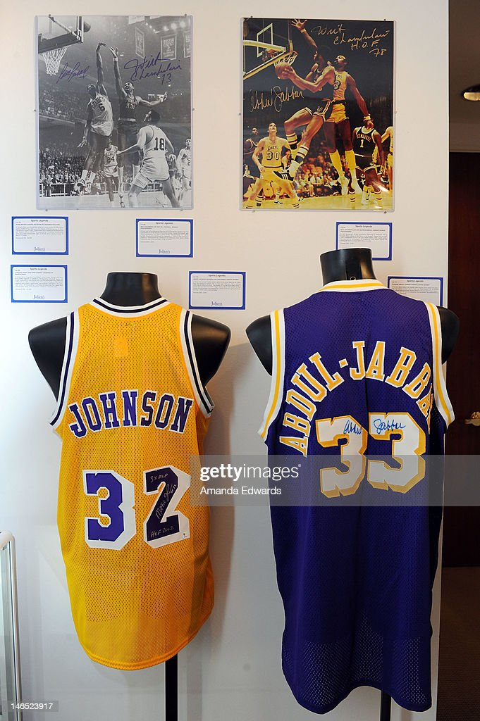 A Los Angeles Lakers replica home jersey signed by <a gi-track='captionPersonalityLinkClicked' href=/galleries/search?phrase=Magic+Johnson&family=editorial&specificpeople=157511 ng-click='$event.stopPropagation()'>Magic Johnson</a> (L) and a Los Angeles Lakers replica away jersey signed by <a gi-track='captionPersonalityLinkClicked' href=/galleries/search?phrase=Kareem+Abdul-Jabbar&family=editorial&specificpeople=206219 ng-click='$event.stopPropagation()'>Kareem Abdul-Jabbar</a> are displayed at the Julien's Auctions press call for Music Icons And Sports Legends Memorabilia Auction at Julien's Auctions Gallery on June 18, 2012 in Beverly Hills, California.