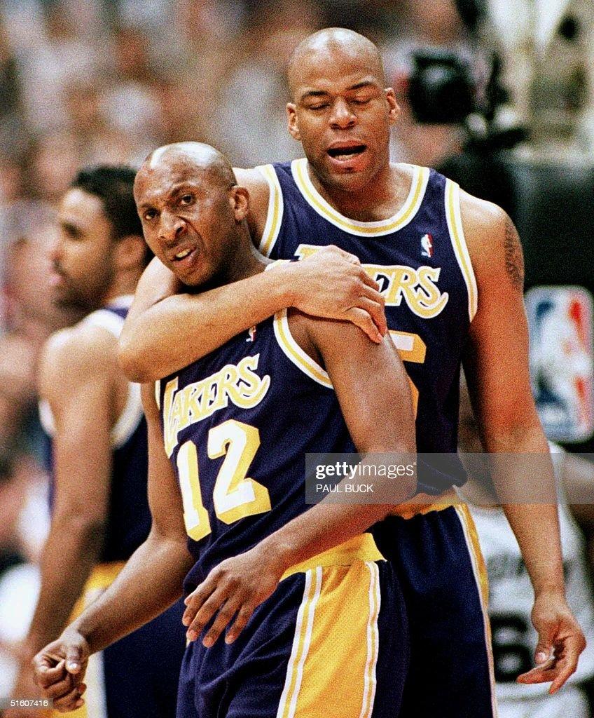 Los Angeles Lakers Sean Rooks R holds teammate De