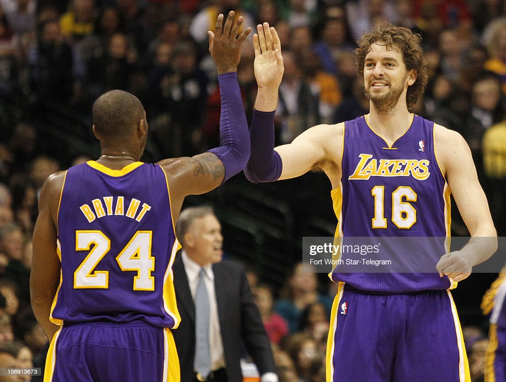 Los Angeles Lakers shooting guard Kobe Bryant (24) and power forward Pau Gasol (16) celebrate in the first half of an NBA game against the Dallas Mavericks at the American Airlines Center on Saturday November 24, 2012, in Dallas, Texas.