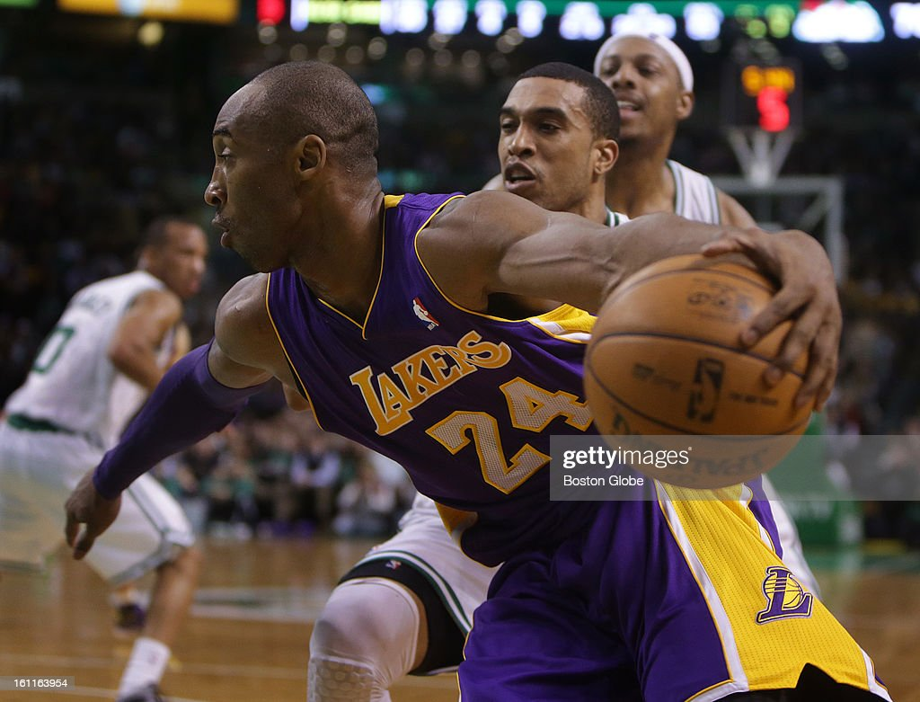 Los Angeles Lakers shooting guard Kobe Bryant (#24) looks for a lane as he uses a spin move on Boston Celtics shooting guard Courtney Lee (#11) in the third quarter as the Boston Celtics play the Los Angeles Lakers at TD Garden.