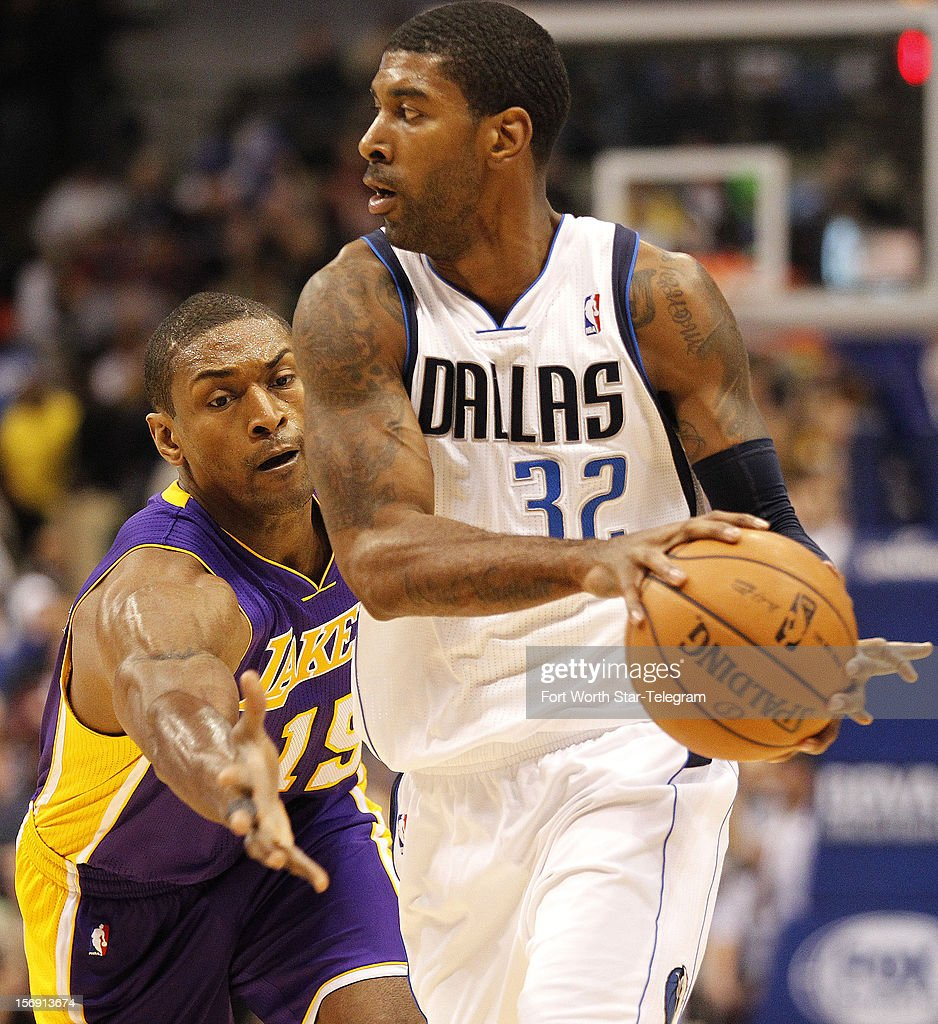 Los Angeles Lakers small forward Metta World Peace (15) pressures Dallas Mavericks shooting guard O.J. Mayo (32) in the first half at the American Airlines Center on Saturday November 24, 2012, in Dallas, Texas.