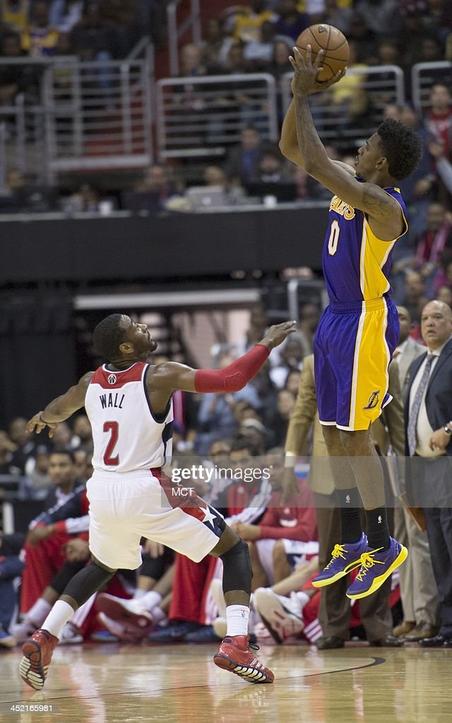 Los Angeles Lakers small forward Nick Young (0) shoots over Washington Wizards point guard John Wall (2) during the second half of their game played at the Verizon Center in Washington, Tuesday, November 26, 2013. Washington defeated Los Angeles 116-111.