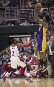 Los Angeles Lakers small forward Nick Young shoots over Washington Wizards point guard John Wall during the second half of their game played at the...