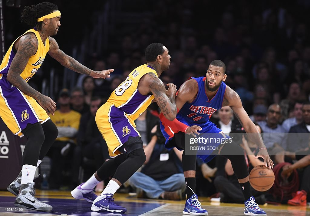 Los Angeles Lakers Tarik Black and Jordan Hill guard Detroit Pistons Greg Monroe at Staples Center in Los Angeles California March 10 2015 AFP PHOTO...