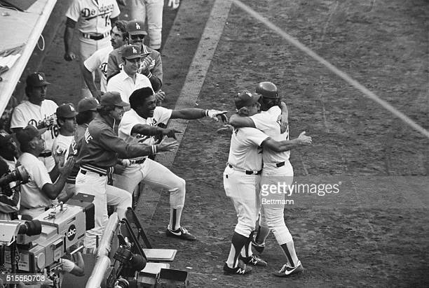 Los Angeles Dodgers manager Tommy Lasorda comes out of the dugout and hugs Steve Yeager after Yeager hit a home run following Pedro Guerrero's homer...