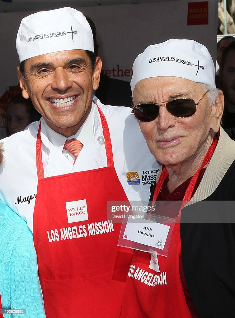 Los Angeles Mayor <a gi-track='captionPersonalityLinkClicked' href=/galleries/search?phrase=Antonio+Villaraigosa&family=editorial&specificpeople=178925 ng-click='$event.stopPropagation()'>Antonio Villaraigosa</a> (L) and actor <a gi-track='captionPersonalityLinkClicked' href=/galleries/search?phrase=Kirk+Douglas+-+Actor&family=editorial&specificpeople=13450359 ng-click='$event.stopPropagation()'>Kirk Douglas</a> attend the Los Angeles Mission's Thanksgiving for skid row homeless at the Los Angeles Mission on November 21, 2012 in Los Angeles, California.