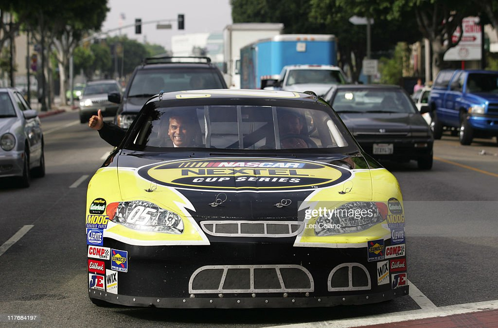 Los Angeles Mayor Antonio Villaraigosa gives a thumbs up as he is driven to work by NASCAR driver Michael Waltrip in a NEXTEL Cup Series race car...