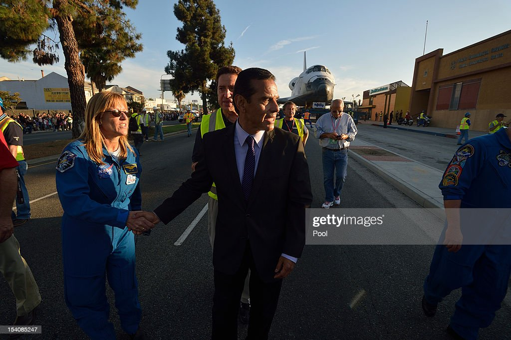 Los Angeles Mayor Antonio Villaraigosa greets astronauts near the Space Shuttle Endeavour on Crenshaw Blvd. enroute to the California Science Center during its final journey on October 13, 2012 in Inglewood, California. Endeavour is on its last mission - a 12-mile creep through city streets, past an eclectic mix of strip malls, mom-and-pop shops, tidy lawns and faded apartment buildings. Its final destination is the California Science Center in South Los Angeles where it will be put on display. NASA's Space Shuttle Program ended in 2011 after 30 years and 135 missions.