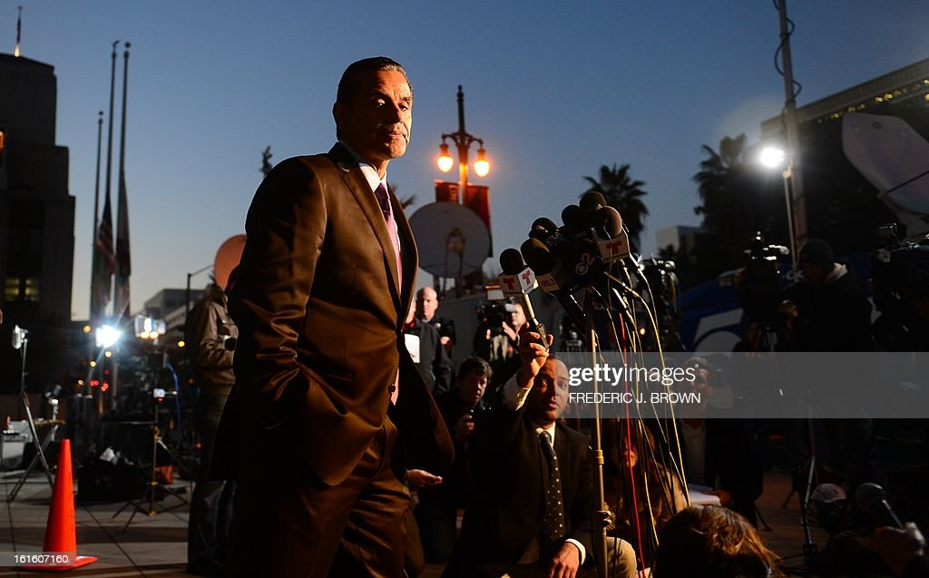 Los Angeles Mayor Antonio Villaraigosa turns away from the microphones after addressing the media outside police headquarters in downtown Los Angeles on February 12, 2013 in California, in regards to the case of suspected cop killer Christopher Dorner. The LA Times reported a single gunshot was heard as police moved in on a mountain cabin where Dorner was believed to be barricaded in Big Bear, some 100 miles east of downtown Los Angeles. Meanwhile, a Los Angeles Police Department (LAPD) spokesman was cited as saying the force believed Dorner died inside the burning cabin in the mountains. AFP PHOTO / Frederic J. BROWN