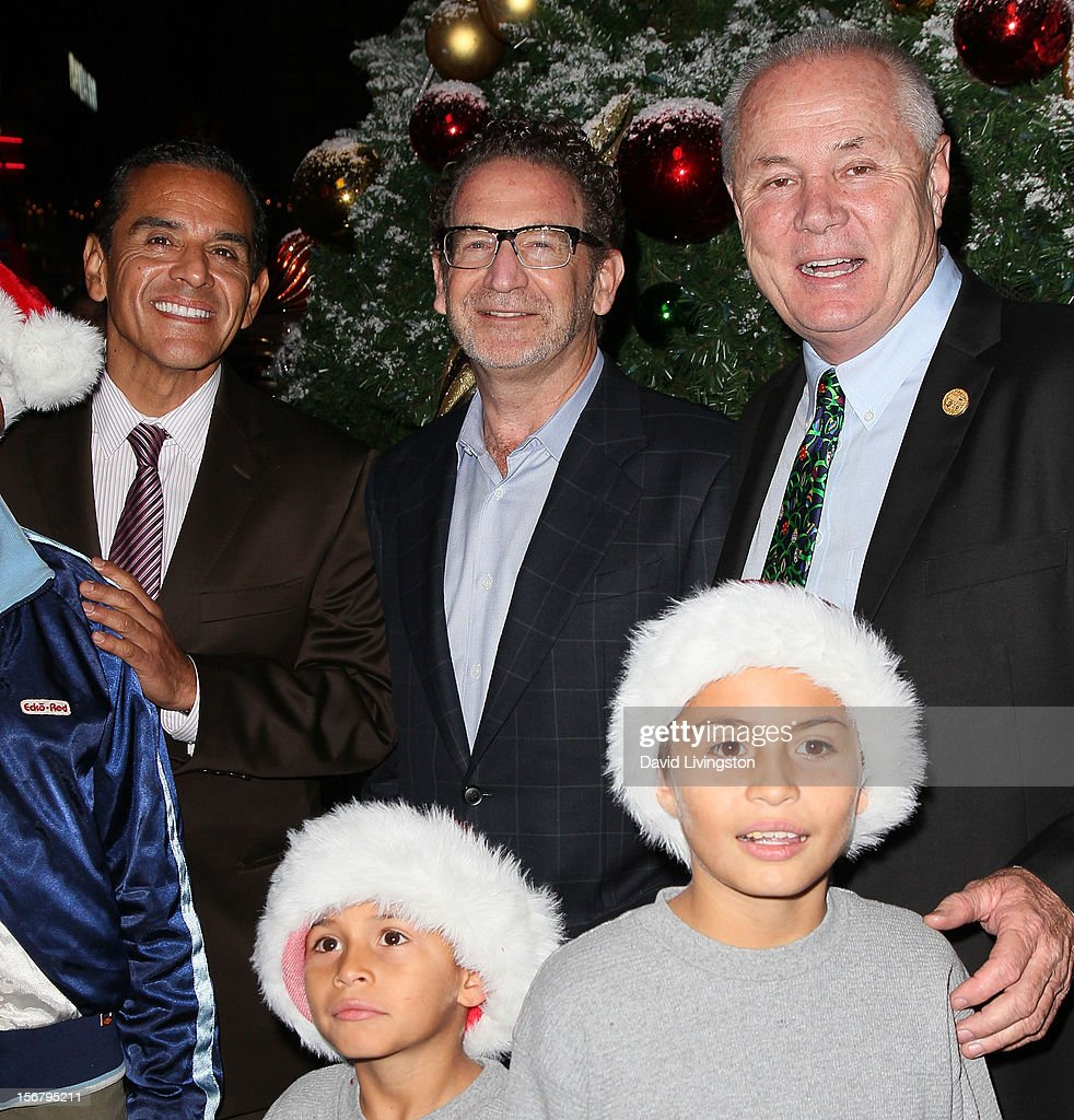 Los Angeles Mayor Antonio Villaraigosa, Universal Studios Hollywood president Larry Kurzweil and Los Angeles City Councilmember Tom LaBonge attend Universal CityWalk Tree Lighting - Light Show Spectacular at 5 Towers Outdoor Concert Arena on November 20, 2012 in Universal City, California.