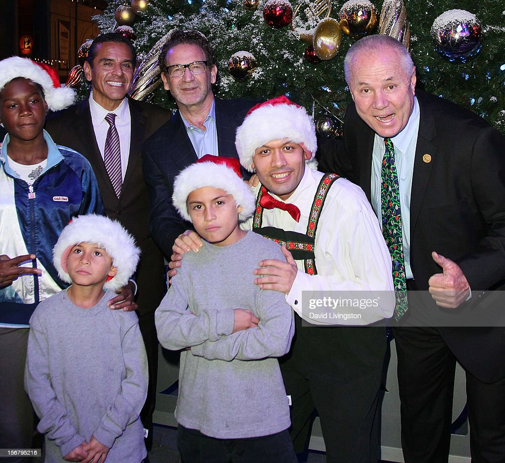 Los Angeles Mayor Antonio Villaraigosa, Universal Studios Hollywood president Larry Kurzweil and Los Angeles City Councilmember Tom LaBonge attend the Universal CityWalk Tree Lighting - Light Show Spectacular at 5 Towers Outdoor Concert Arena on November 20, 2012 in Universal City, California.