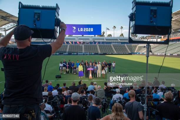 TOPSHOT Los Angeles Mayor Eric Garcetti addresses a press conference at StubHub Center Stadium to announce that Los Angeles has reached a deal with...