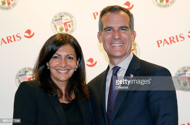 Los Angeles mayor Eric Garcetti and Paris Mayor Anne Hidalgo pose after signing a partnership agreement regarding the Olympic Games during a twoday...