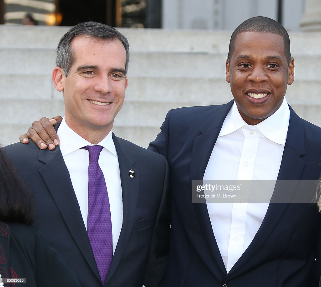 Los Angeles Mayor <a gi-track='captionPersonalityLinkClicked' href=/galleries/search?phrase=Eric+Garcetti&family=editorial&specificpeople=635706 ng-click='$event.stopPropagation()'>Eric Garcetti</a> and Recording artist Shawn 'Jay Z' Carter make an announcement on the Steps of City Hall Downtown Los Angeles for a Labor Day Music Festival at Los Angeles City Hall on April 16, 2014 in Los Angeles, California.