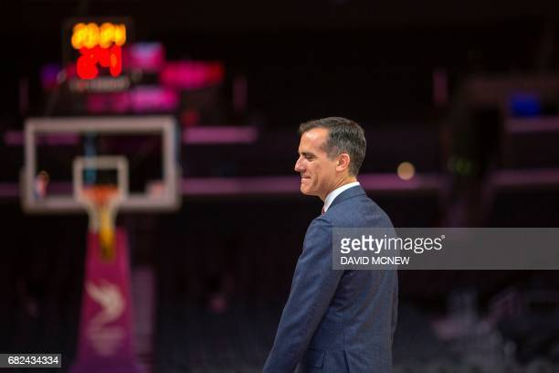 Los Angeles mayor Eric Garcetti arrives to a press conference at Staples Center concluding the IOC Evaluation Commission visit to Los Angeles...