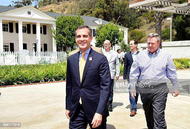 Los Angeles Mayor Eric Garcetti followed by USOC CEO Scott Blackmun make their way to start a press conference to officially launch a Los Angeles...