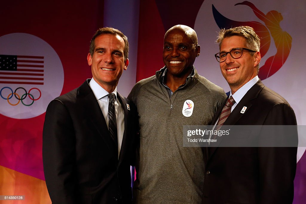 Los Angeles Mayor Eric Garcetti, Olympian Carl Lewis, and Casey Wasserman, Chairman LA2024, address the media at the USOC Olympic Media Summit at The Beverly Hilton Hotel on March 8, 2016 in Beverly Hills, California.