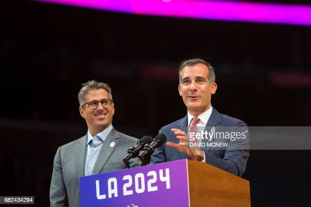 Los Angeles mayor Eric Garcetti speaks as Chairman of the LA 2024 Casey Wasserman looks on during a press conference at Staples Center concluding the...