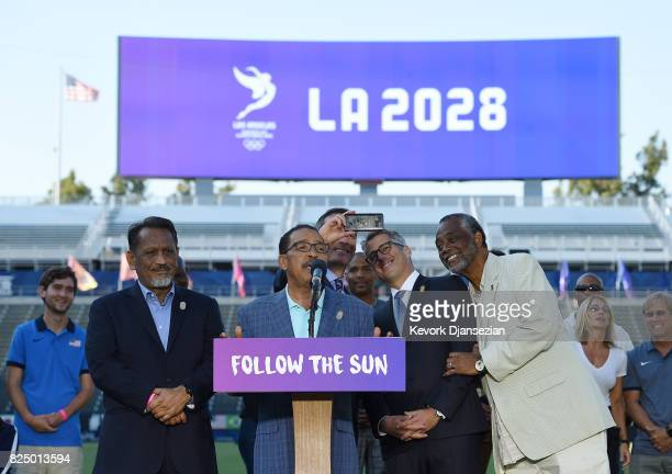 Los Angeles Mayor Eric Garcetti takes a selfie with LA 2024 Bid Chairman Casey Wasserman while Los Angeles City Council President Herb Wesson speaks...