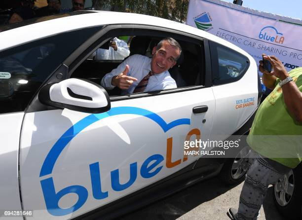 Los Angeles Mayor Eric Garcetti tries out a car at the launch of what is being billed as the nation's largest 'Electric Vehicle' car sharing program...
