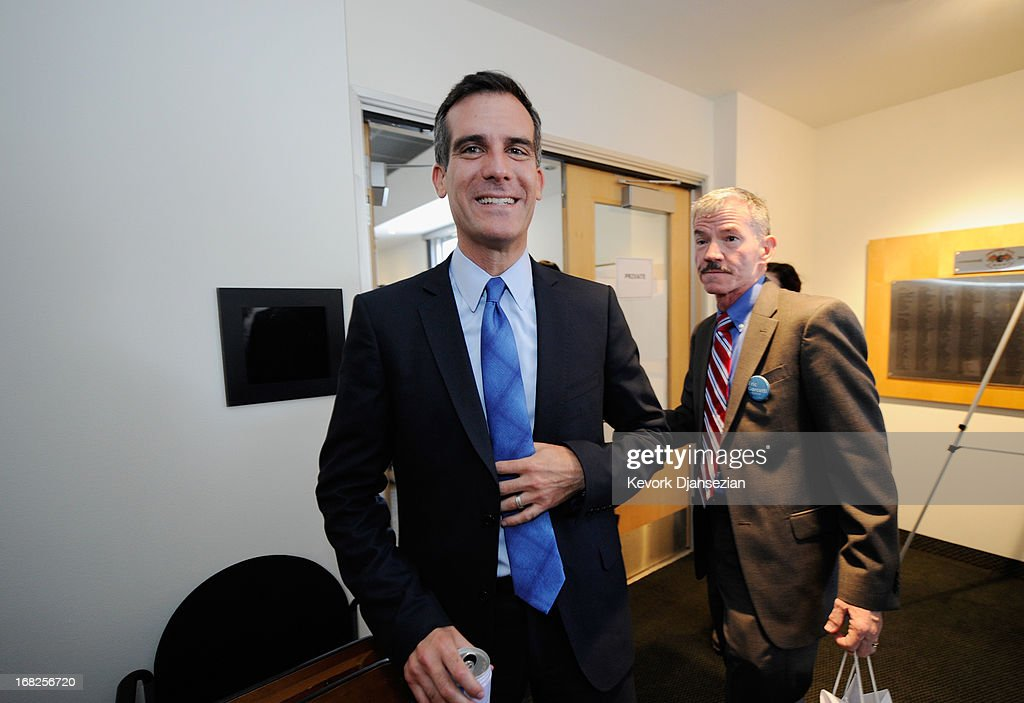 Los Angeles mayoral candidate and City Councilman <a gi-track='captionPersonalityLinkClicked' href=/galleries/search?phrase=Eric+Garcetti&family=editorial&specificpeople=635706 ng-click='$event.stopPropagation()'>Eric Garcetti</a> leaves after participating in debate hosted by Zocalo Public Square and KCRW with City Controller Wendy Greuel on May 7, 2013 in Los Angeles, California. Garcetti and Greuel are preparing for a May 21 runoff vote to determine which will be the next mayor of Los Angeles.