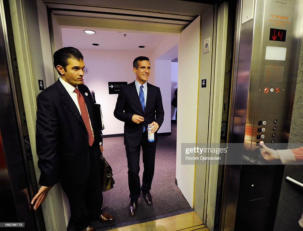 Los Angeles mayoral candidate and City Councilman <a gi-track='captionPersonalityLinkClicked' href=/galleries/search?phrase=Eric+Garcetti&family=editorial&specificpeople=635706 ng-click='$event.stopPropagation()'>Eric Garcetti</a> (C) leaves after participating in debate hosted by Zocalo Public Square and KCRW with City Controller Wendy Greuel at the Petersen Automotive Museum, on May 7, 2013 in Los Angeles, California. Garcetti and Greuel are preparing for a May 21 runoff vote to determine which will be the next mayor of Los Angeles.