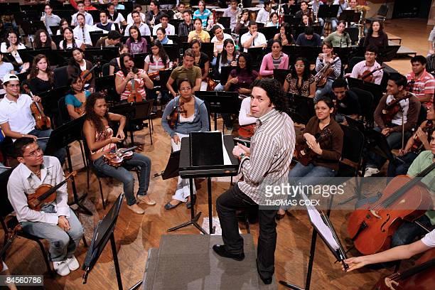Los Angeles Philharmonic Orchestra's conductor Venezuelan Gustavo Dudamel congratulates the Venezuelan young musicians after a disc recording in...
