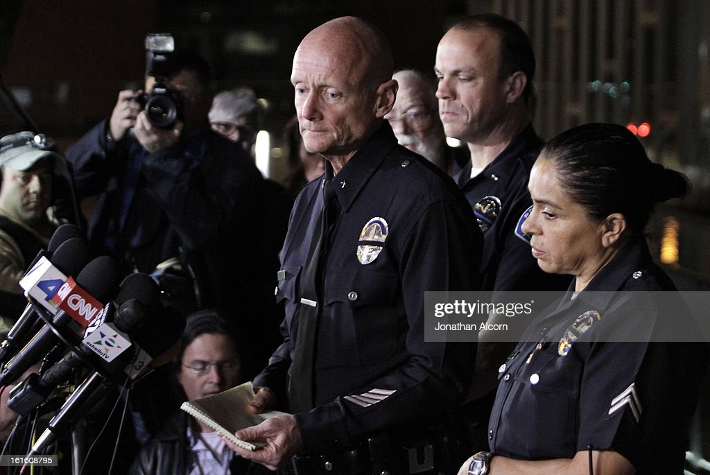 Los Angeles Police Department Commander Andrew Smith listens to a reporter's question during a media briefing outside the Police Administration Headquarters regarding former LAPD officer Christopher Dorner, February 12, 2013 in Los Angeles, California. Dorner barricaded himself in a cabin near Big Bear, California which later caught fire. According to the LAPD the cabin remains too hot to enter and a body has not been located.