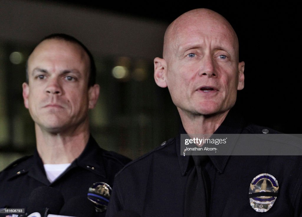 Los Angeles Police Department Commander Andrew Smith (R) speaks during a media briefing outside the Police Administration Headquarters regarding former LAPD officer Christopher Dorner, February 12, 2013 in Los Angeles, California. Dorner barricaded himself in a cabin near Big Bear, California which later caught fire. According to the LAPD the cabin remains too hot to enter and a body has not been located.