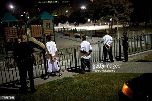 Los Angeles Police Department gang unit officers question and search inside Lafayette Park confirmed MS13 street gang members September 14 2007 in...