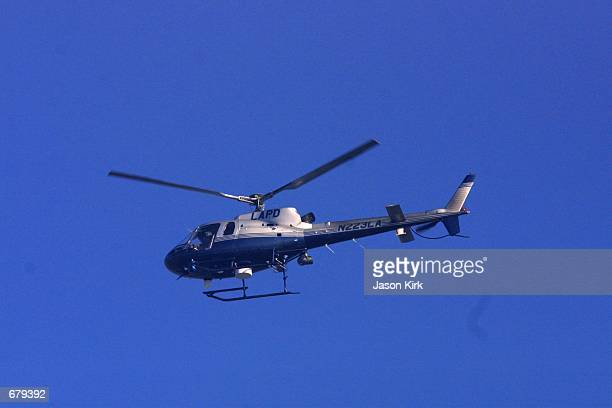 Los Angeles Police Department helicopter hovers over the Shubert Theatre during the 53rd annual Primetime Emmy Awards November 4 2001 in Los Angeles...