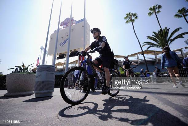Los Angeles Police Department officer on a bicycle patrols the parking lot of Dodger Stadium prior to the home opener aginst the Pittsburgh Pirates...
