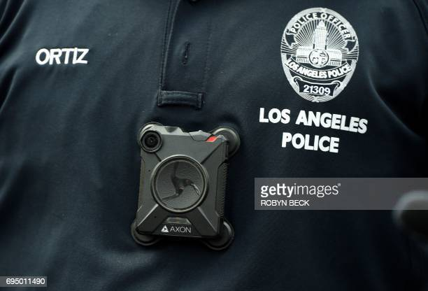 A Los Angeles Police Department officer wears a body camera at the Los Angeles Gay Pride Resist March June 11 2017 in Hollywood California / AFP...