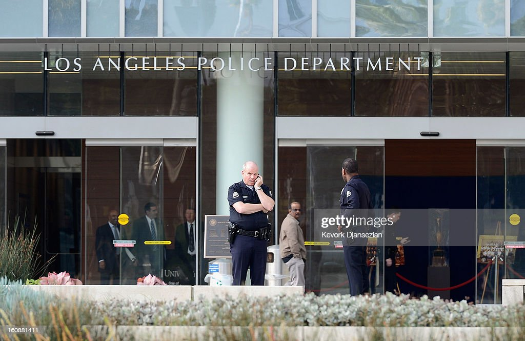 Los Angeles Police Department officers are deployed around the police headquarters on February 7, 2013 in Los Angeles, California. A former Los Angeles police officer Christopher Jordan Dorner, 33, who had allegedly warned he would target law enforcement, is suspected of firing on two LAPD officers and ambushing two other officers, killing one. Dorner is also a suspect in two weekend killings of Monica Quan and Keith Lawrence who were found dead in a car inside a parking structure.