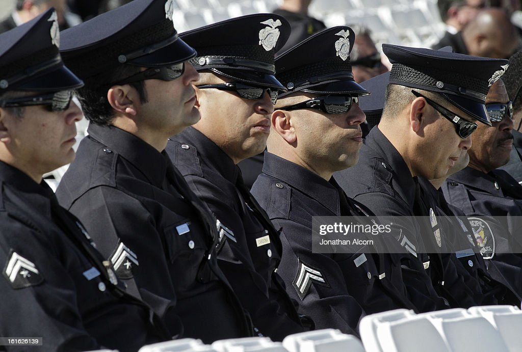 Los Angeles Police Department officers attend the funeral service for Riverside police Officer Michael Crain at Grove Community Church in Riverside, California, February 13, 2013. Officer Crain was allegedly killed by ex LAPD officer Chris Dorner on February 7, 2013.