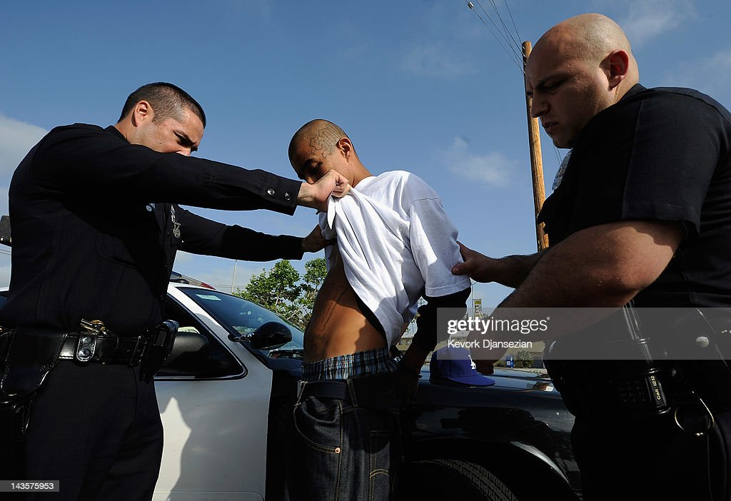 Los Angeles Police Department officers from the 77th Street division detain a twenty-year old 'Street Villains' gang member who was recently released from prison on April 29, 2012 in Los Angeles, California. The 77th Street division patrol the same neighborhood that truck driver Reginald Denny was nearly beaten to death by a group of black assailants at the intersection of Florence and Normandie Avenues. It's been 20 years since the verdict was handed down in the Rodney King case that sparked infamous Los Angeles riots.