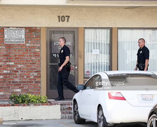 Los Angeles Police officers are seen in Los Angeles outside the Jesun Acupuncture clinic on March 16 2015 in Los Angeles California