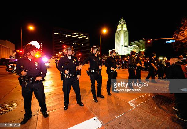 Los Angeles Police Officers in riot gear deploy around the Los Angeles City Hall after the deadline to dismantle the occupy campsite expired on...