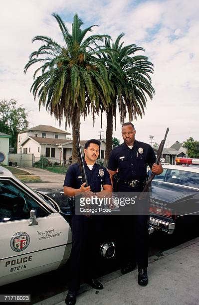 Los Angeles Police Officers Raymond Terrone and Curtis Woodle pose during a 1988 Los Angeles California patrol of the South Central region of town...