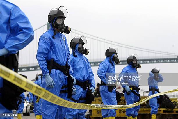 Los Angeles police officers wearing contamination suits secure the area following the explosion of a 'dirty bomb' during a simulated attack at a dock...