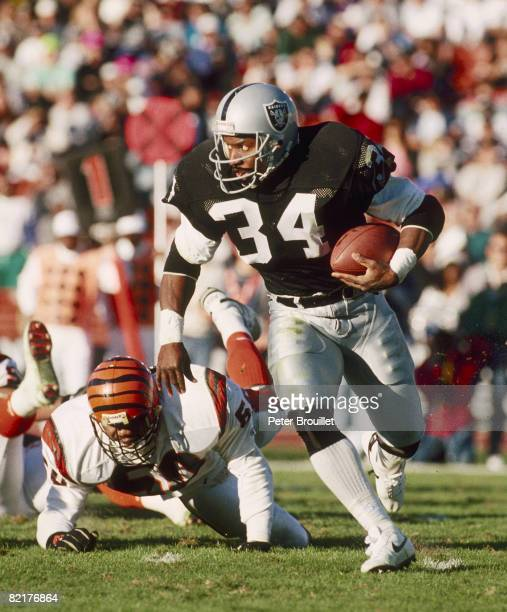 Los Angeles Raiders running back Bo Jackson running past a Cincinnati Bengals defender in the Raiders 247 victory over the Bengals on December 16...