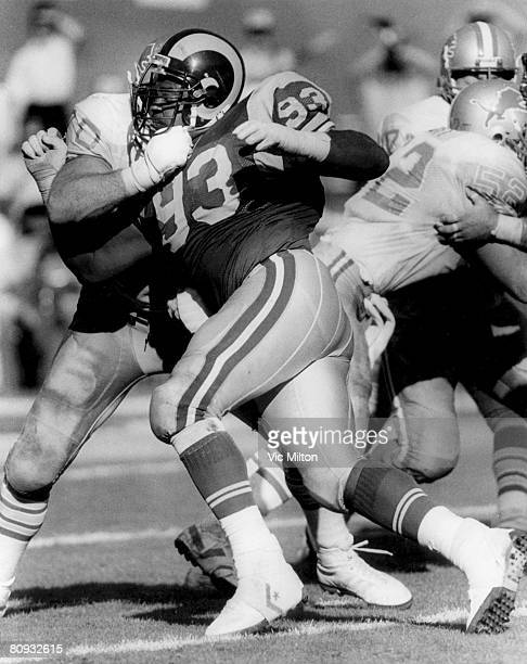 Los Angeles Rams defensive end Doug Reed is held by Detroit Lions guard Keith Dorney in a 1410 win over the Detroit Lions on October 19 1986 at...
