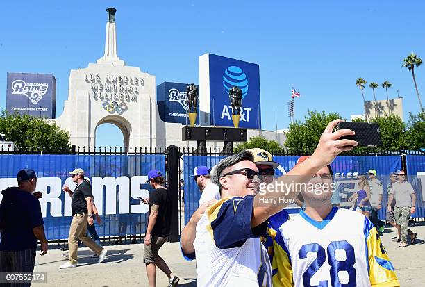 Los Angeles Rams fans take a selfie before the Los Angeles Rams home opening game against the Seattle Seahawks at the Los Angeles Coliseum on...