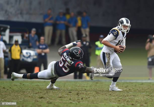 Los Angeles Rams Quarterback Jared Goff escapes the grasp of Houston Texans Linebacker Benardrick McKinney during an NFL game between the Houston...