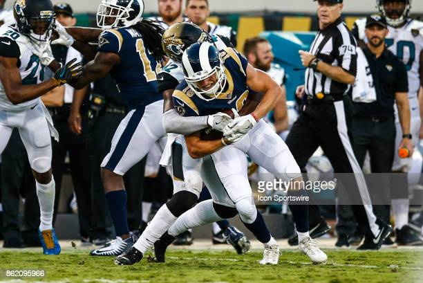 Los Angeles Rams wide receiver Cooper Kupp is tacked by Jacksonville Jaguars safety Barry Church after a catch during the game between the Los...